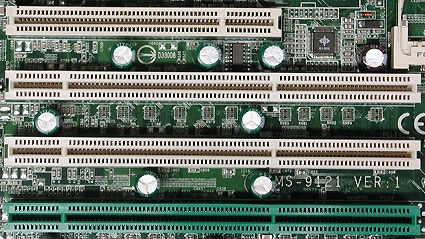 A classic 32-bit PCI slot above, with three 64-bit PCI-X slots below. The green slot offers ZCR (Zero Channel RAID) support.